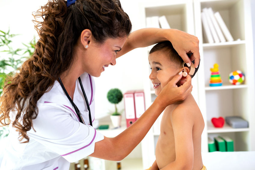 Little boy getting his hearing aids