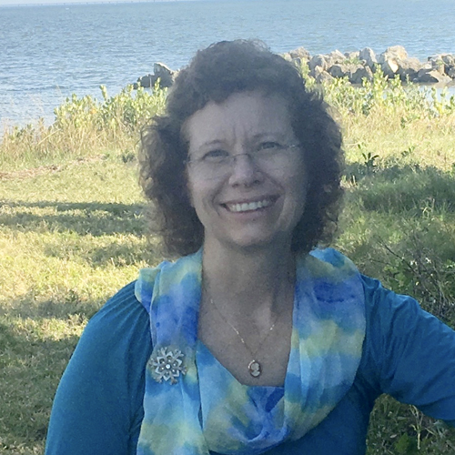 image of Cheri Moore outside by the ocean