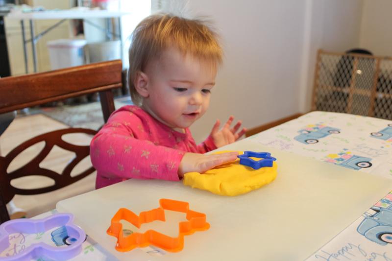 girl patting the gluten free playdoh