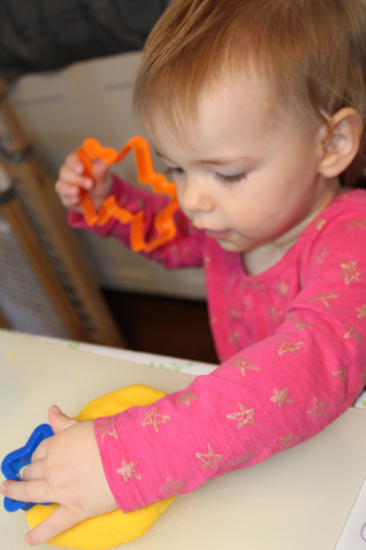 young girl playing with playdoh